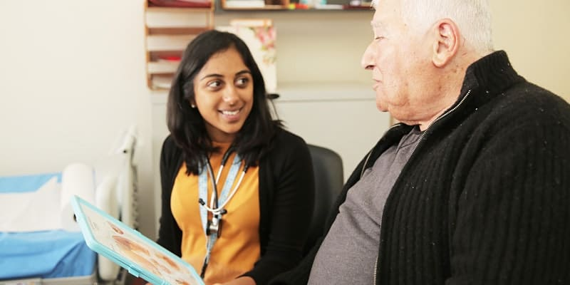 picture of physiotherapist showing elderly patient information